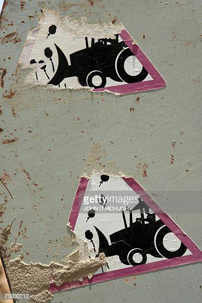Antipoppy production stickers are seen on the side of an Afghan truck used to transport unexploded ordnance near the Provincial Reconstruction Team's...