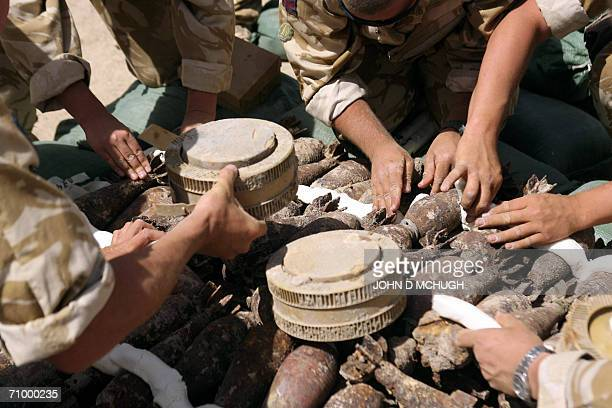 British soldiers from the Bomb Squad Helmand Task Force load move and destroy unexploded ordnance at the Provincial Reconstruction Team's base in...