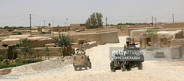 British soldiers from the Helmand Task Force provide security as a convoy transports unexploded ordnance near the Provincial Reconstruction Team's...