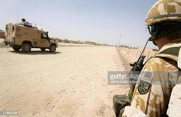 Lashkar Gah, AFGHANISTAN: - File picture taken 13 May 2006 showing British soldiers from the 16 Air Assault Brigade, on foot and using Snatch Land...