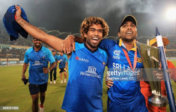 Lasith Malinga and Mahela Jayawardena of Sri Lanka celebrate their team's win over India after the ICC World Twenty20 Bangladesh 2014 Final between...