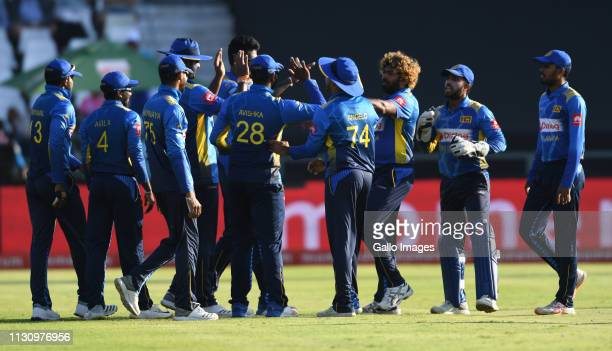 Lasith Malinga and team mates of Sri Lanka celebrate the wicket of Quinton de Kock of South Africa during the 5th Momentum ODI match between South...