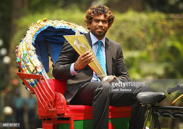 Lasith Malinga captain of Sri Lanka poses with the trophy on a rickshaw during a photocall after Sri Lanka won the Final of the ICC Men's World...