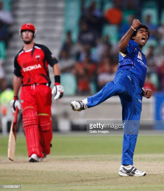 Lasith Malinga of Mumbai Indians celebrates a wicket during the Airtel Champions League Twenty20 match between Mumbai Indians and South Australian...
