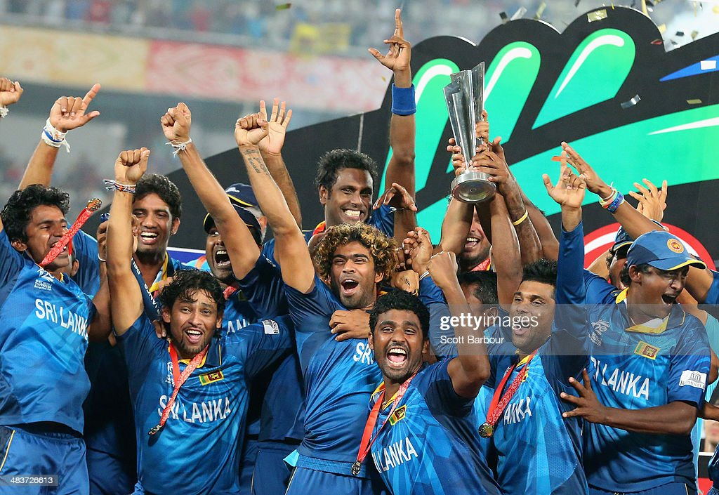Lasith Malinga of Sri Lanka and his team celebrate with the trophy on the podium after winning the Final of the ICC World Twenty20 Bangladesh 2014 between India and Sri Lanka at Sher-e-Bangla Mirpur Stadium on April 4, 2014 in Dhaka, Bangladesh.