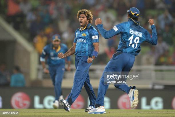Lasith Malinga of Sri Lanka celebrates bowling Dwayne Smith of the West Indies during the ICC World Twenty20 Bangladesh 2014 semi final between Sri...