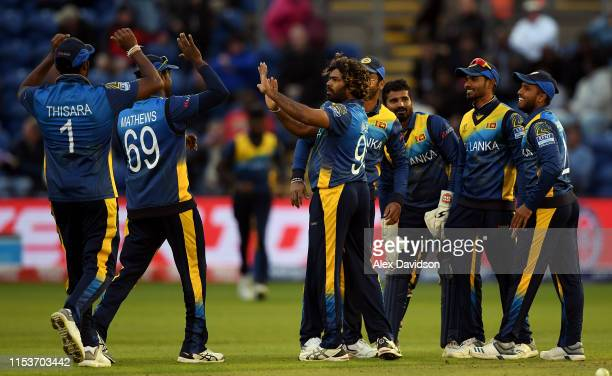 Lasith Malinga of Sri Lanka celebrates taking the wicket of Dawlat Zadran of Afghanistan with his teammates during the Group Stage match of the ICC...