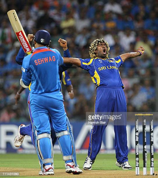 Lasith Malinga of Sri Lanka celebrates the wicket of Virender Sehwag of India during the 2011 ICC World Cup Final between India and Sri Lanka at...