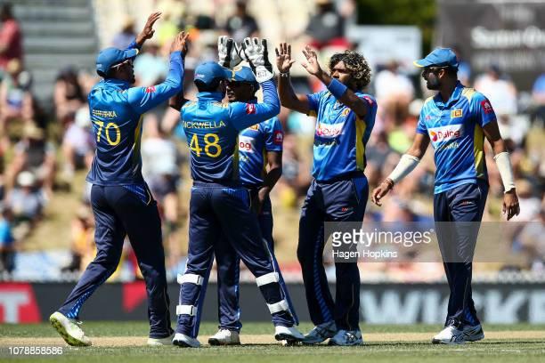 Lasith Malinga of Sri Lanka celebrates with Danushka Gunathilaka and Niroshan Dickwella after taking the wicket of Colin Munro of New Zealand during...