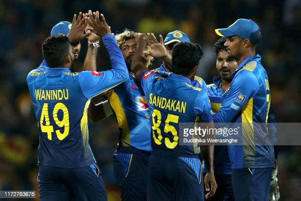 Lasith Malinga of Sri Lanka celebrates with his team mates after takes wicket of Colin Munro of New Zealand during the Twenty20 International match...