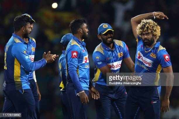 Lasith Malinga of Sri Lanka celebrates with team mates he after takes wicket of Ross Taylor during the Twenty20 International match between Sri Lanka...