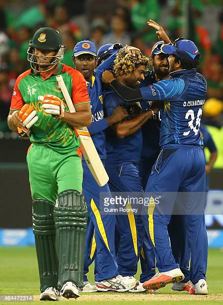 Lasith Malinga of Sri Lanka is congratulated by team mates after getting the wicket of Taskin Ahmed of Bangladesh during the 2015 ICC Cricket World...
