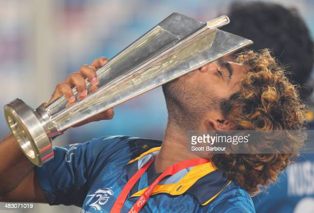 Lasith Malinga of Sri Lanka kisses the trophy after winning the Final of the ICC World Twenty20 Bangladesh 2014 between India and Sri Lanka at...