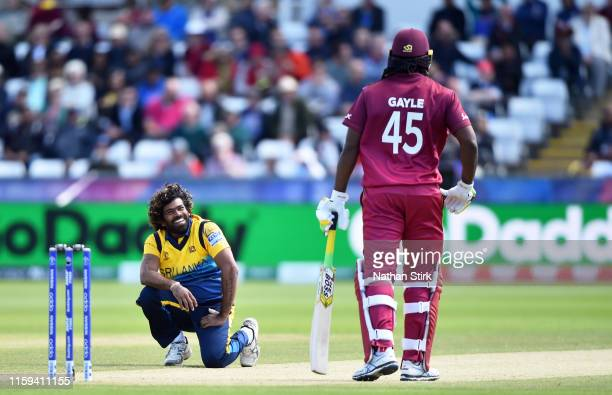 Lasith Malinga of Sri Lanka laughs with Chris Gayle of West Indies after he bowls a no ball during the Group Stage match of the ICC Cricket World Cup...
