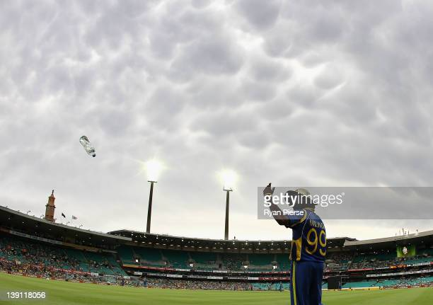 Lasith Malinga of Sri Lanka looks on from the field as storm clouds approach during game six of the One Day International series between Australia...