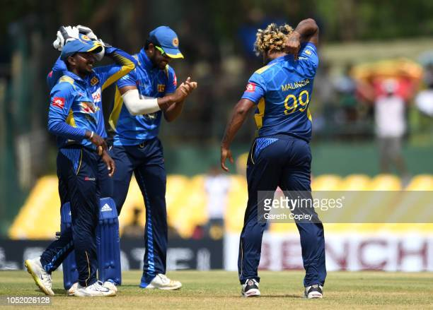 Lasith Malinga of Sri Lanka points to his shirt number as he celebrates dismissing Liam Dawson of England during the 2nd One Day International match...