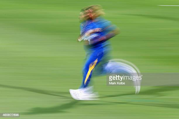Lasith Malinga of Sri Lanka runs in to bowl during the 2015 Cricket World Cup match between Sri Lanka and Scotland at Bellerive Oval on March 11 2015...