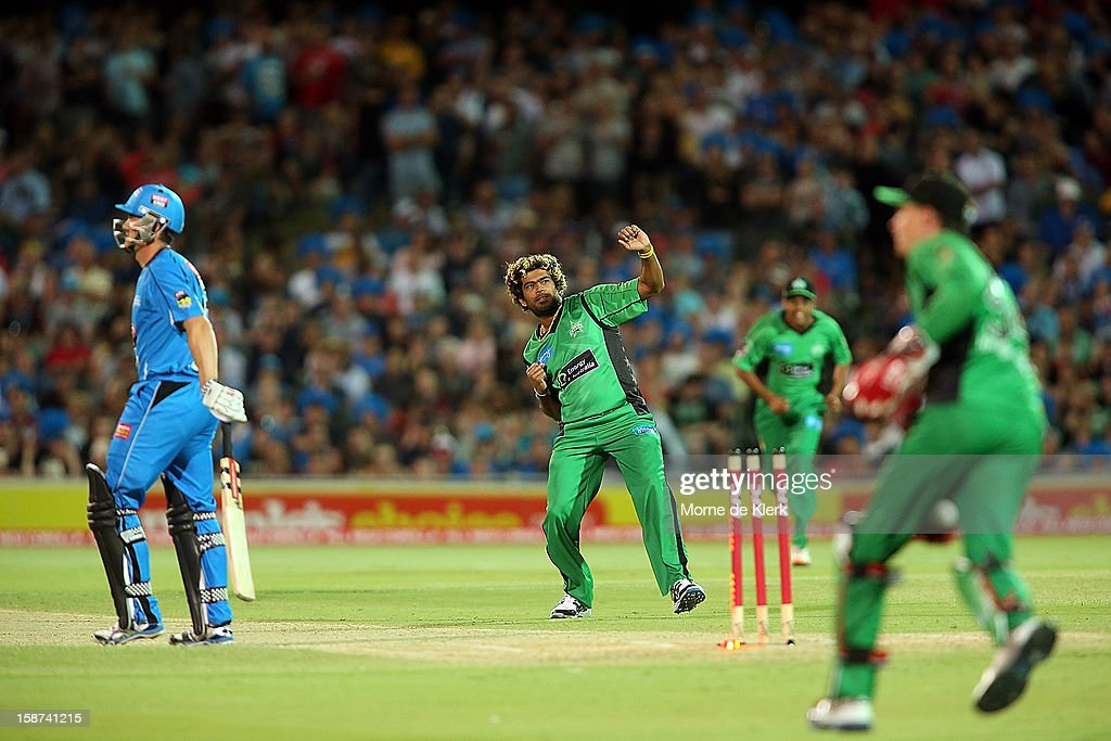Lasith Malinga (C) of the Stars celebrates after bowling out Michael Klinger of the Strikers during the Big Bash League match between the Adelaide Strikers and the Melbourne Stars at Adelaide Oval on December 27, 2012 in Adelaide, Australia.