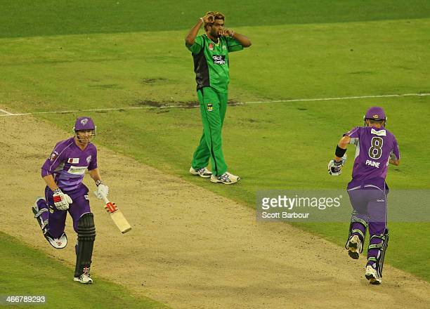 Lasith Malinga of the Stars looks on as George Bailey and Tim Paine of the Hurricanes run between the wickets during the Big Bash League Semi Final...