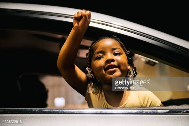 Lasiya Lakes raises her fist in the air while chanting Black Lives Matter on August 26, 2020 in Kenosha, Wisconsin. As the city declared a state of...