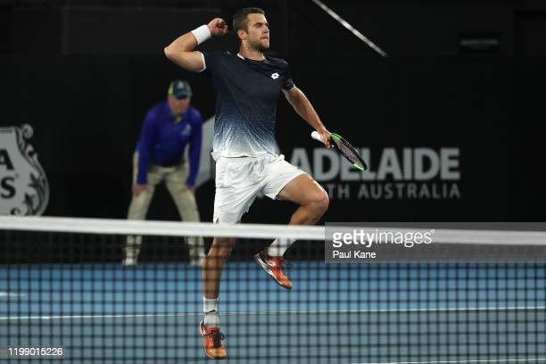 Laslo Djere of Serbia celebrates his first round win after defeating Alexei Popyrin of Australia during day one of the 2020 Adelaide International at...