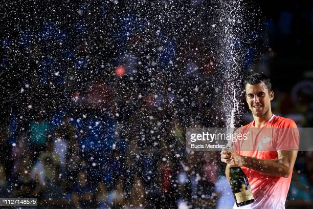 Laslo Djere of Serbia celebrates the championship after defeating Felix Auger-Aliassime of Canada at the singles final of the ATP Rio Open 2019 at...