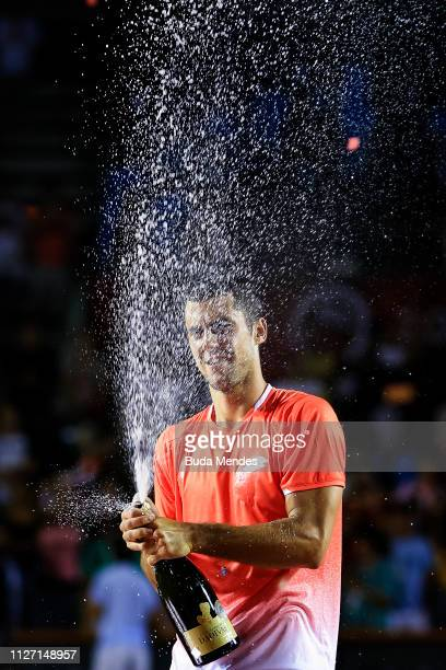 Laslo Djere of Serbia celebrates the victory after defeating Felix Auger-Aliassime of Canada at the singles final of the ATP Rio Open 2019 at Jockey...