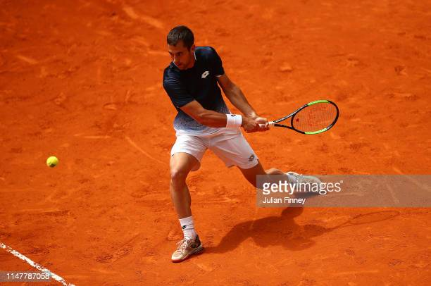 Laslo Djere of Serbia in action against Juan Martin Del Potro of Argentina during day five of the Mutua Madrid Open at La Caja Magica on May 08, 2019...