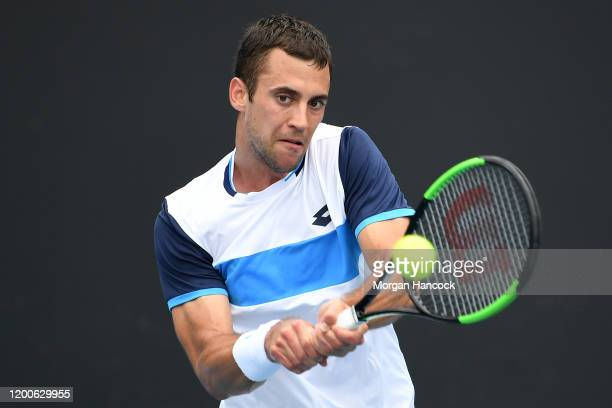 Laslo Djere of Serbia plays a backhand during his Men's Singles first round match against Yoshihito Nishioka of Japan on day one of the 2020...