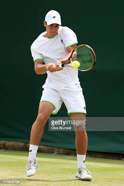 Laslo Djere of Serbia plays a backhand during the Boys' Singles first round match against Cameron Norrie of Great Britain on day six of the Wimbledon...