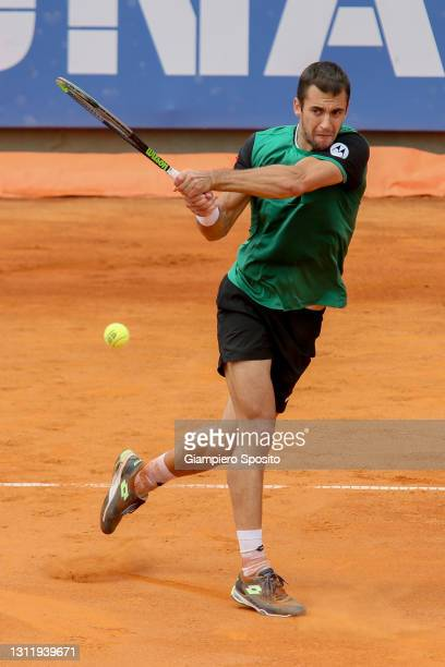 Laslo Djere of Serbia plays a backhand in his final match against Lorenzo Sonego of Italy at the Sardegna Open on April 11, 2021 in Cagliari, Italy.