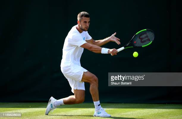 Laslo Djere of Serbia plays a backhand in his Men's Singles first round match against Guido Andreozzi of Argentina during Day two of The...