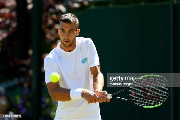 Laslo Djere of Serbia plays a backhand in his Men's Singles second round match against John Millman of Australia during Day four of The Championships...