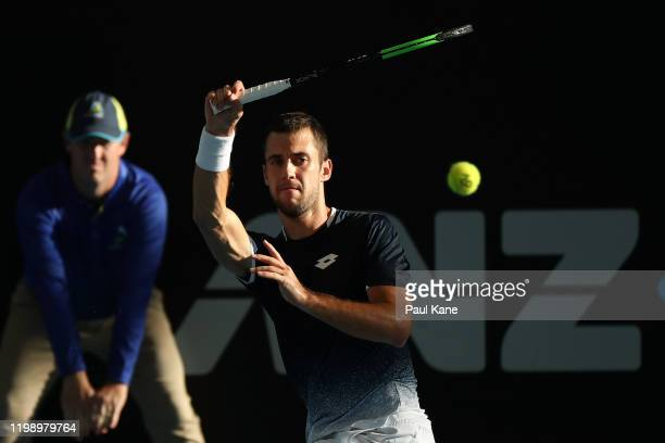 Laslo Djere of Serbia plays a forehand to Alexei Popyrin of Australia during day one of the 2020 Adelaide International at Memorial Drive on January...