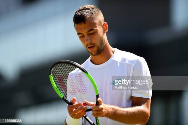 Laslo Djere of Serbia reacts in his Men's Singles second round match against John Millman of Australia during Day four of The Championships -...