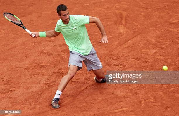 Laslo Djere of Serbia returns a shot in his mens singles third round match against Kei Nishikori of Japan during Day six of the 2019 French Open at...