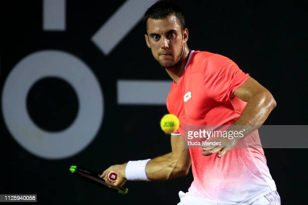 Laslo Djere of Serbia returns a shot to Dominic Thiem of Austria during the ATP Rio Open 2019 at Jockey Club Brasileiro on February 19, 2019 in Rio...