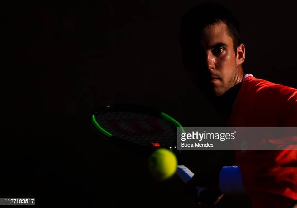 Laslo Djere of Serbia returns a shot to Felix Auger-Aliassime of Canada during the singles final of the ATP Rio Open 2019 at Jockey Club Brasileiro...