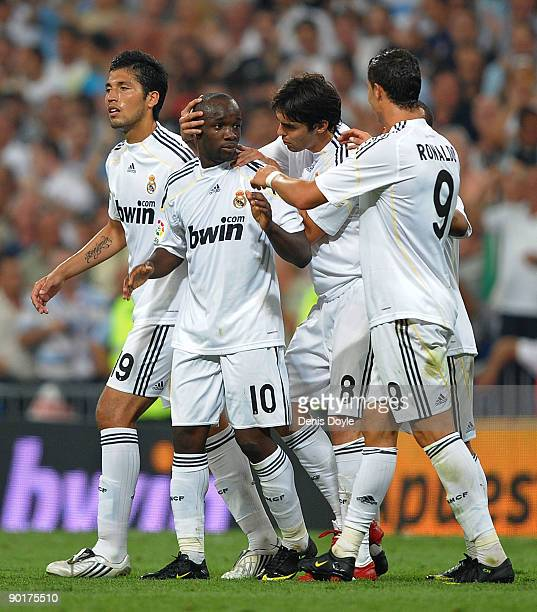 Lass Diarra of Real Madrid is congratulated by Kaka and Cristiano Ronaldo after he scored Real's third goal during the La Liga match between Real...