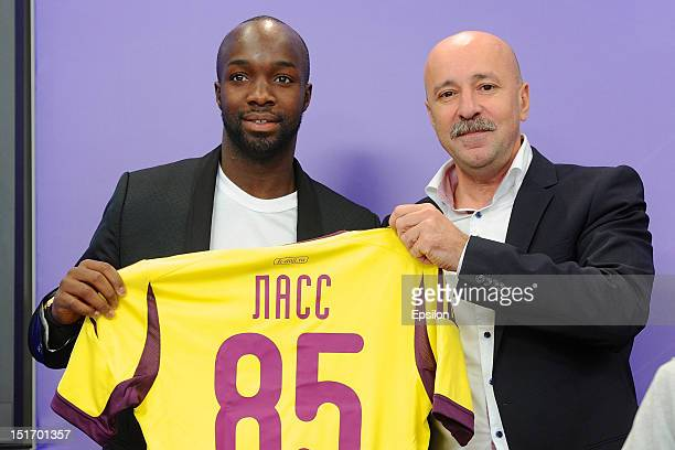 Lass Diarra , the new football player for Anji Makhachkala , stands with head coach Aivaz Kaziakhmedov during a press conference at the RIA News...
