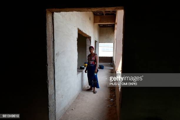A Lassa fever patient's secondary contact stands in a corridor at the Institute of Lassa Fever Research and Control in Irrua Specialist Teaching...