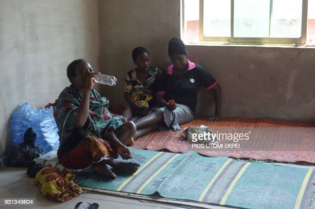 Lassa fever secondary contact and family members of victims lie on the floor at the Institute of Lassa Fever Research and Control in Irrua Specialist...
