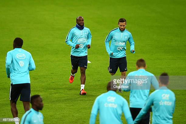 Lassana Diarra and Johan Cabaye of France warm up during the France training session at Wembley Stadium on November 16 2015 in London England