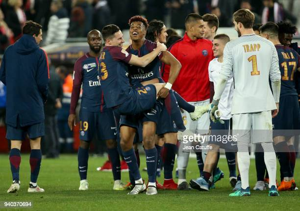 Lassana Diarra Julian Draxler Presnel Kimpembe Alphonse Areola Marco Verratti Kevin Trapp of PSG celebrate the victory following the French League...