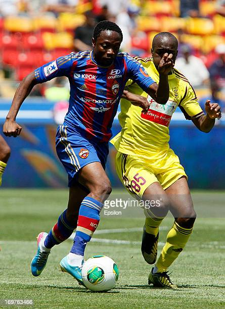 Lassana Diarra of FC Anji Makhachkala is challenged by Ahmed Musa of PFC CSKA Moscow during the Russian Cup Final match between FC Anji Makhachkala...