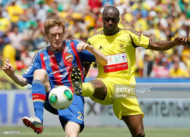 Lassana Diarra of FC Anji Makhachkala is challenged by Rasmus Elm of PFC CSKA Moscow during the Russian Cup Final match between FC Anji Makhachkala...