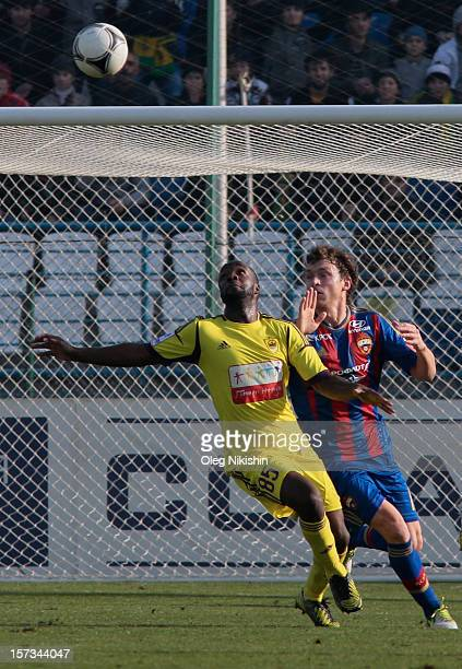 Lassana Diarra of FC Anzhi Makhachkala battles for the ball with SPavel Mamayev of PFC CSKA Moscow during the Russian Premier League match between FC...