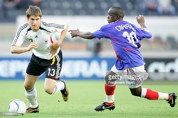 Lassana Diarra of France challenges for the ball with Patrick Helmes of Germany during the UEFA U21's Championship Group A match between France and...