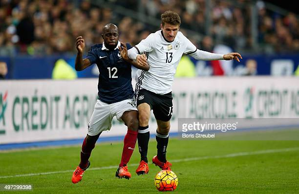 Lassana Diarra of France challenges Thomas Mueller of Germany during the International Friendly match between France and Germany at the Stade de...