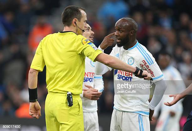Lassana Diarra of OM argues with referee Ruddy Buquet during the French Ligue 1 match between Olympique de Marseille and Paris SaintGermain at New...